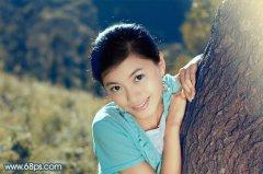 photoshop调出淡雅古典的青黄色调外景美女图片