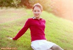 photoshop将偏暗的草地人物图片调出甜美粉红色彩